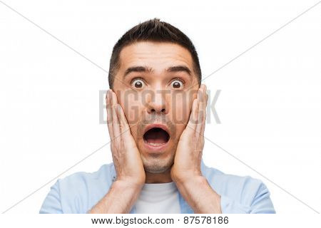 fear, emotions, horror and people concept - scared man shouting and touching his face