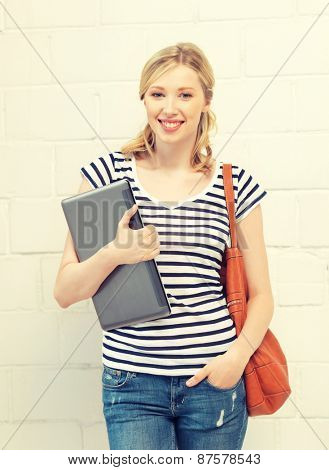 picture of happy and smiling teenage girl with laptop