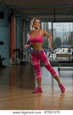 Attractive Woman Rotates Hula Hoop
