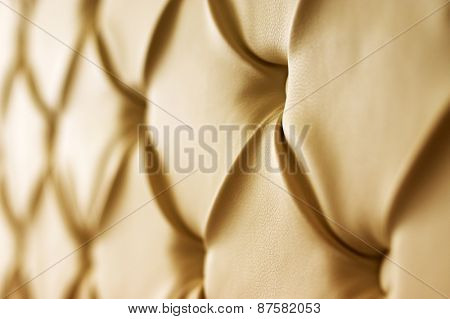 Genuine leather upholstery background for a luxury decoration in beige tones