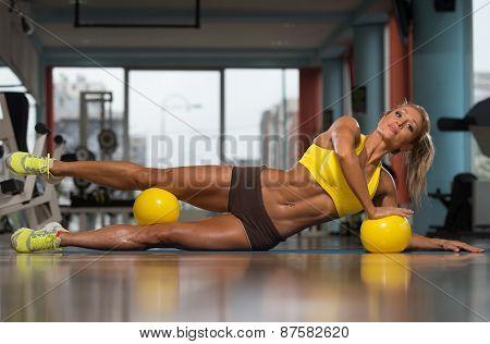 Beautiful Woman Doing Pilates Ball On The Floor