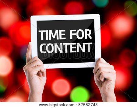 Tablet pc with text Time For Content with bokeh background
