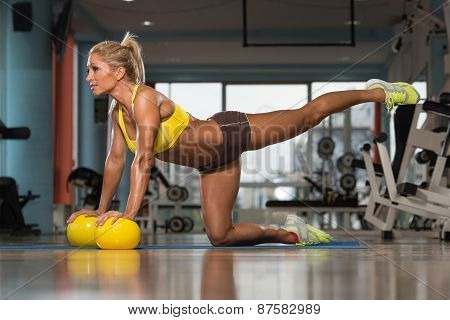 Beautiful Woman Doing Pilates Ball On The Floor