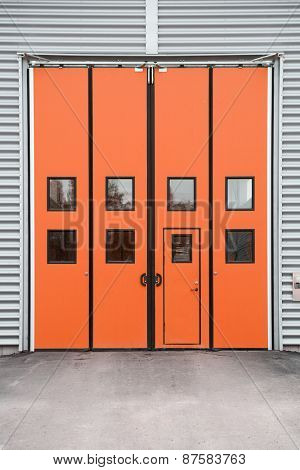 Orange Garage Door on a warehouse building