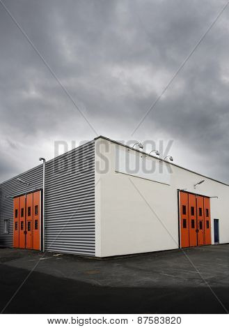Warehouse with red doors at dusk