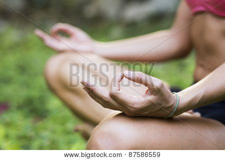 Yoga teacher practicing meditation outdoors