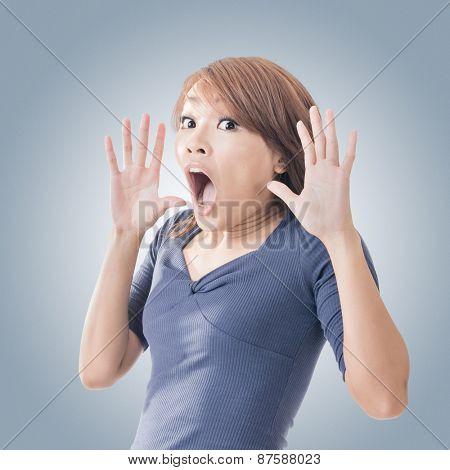 Surprised Asian woman, closeup portrait.