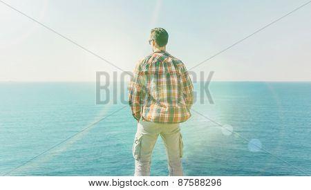 Man Enjoying View Of Sea In Summer