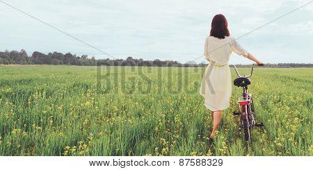 Girl Walking With Bike In Summer