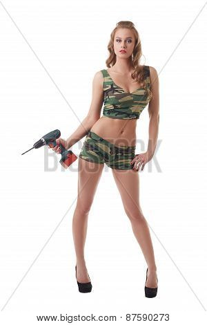 Conceptual photo. Beautiful model armed with drill