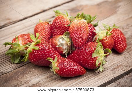 Close-up of strawberries on wooden background