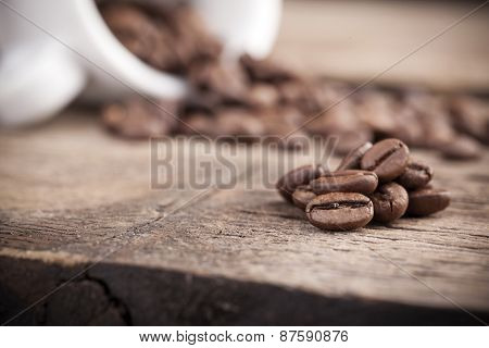Coffee beans on a rustic table