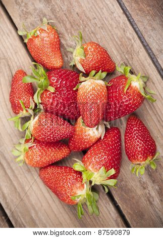 Close-up of ripe strawberries on wooden background