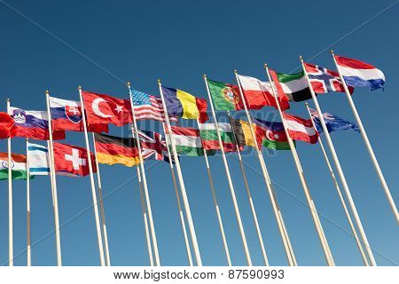 Flags On Flagpoles Fluttering In The Wind