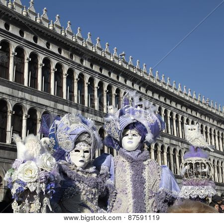 Masked Persons In Ornate Medieval Costume On San Marco Square, Venice, Italy.