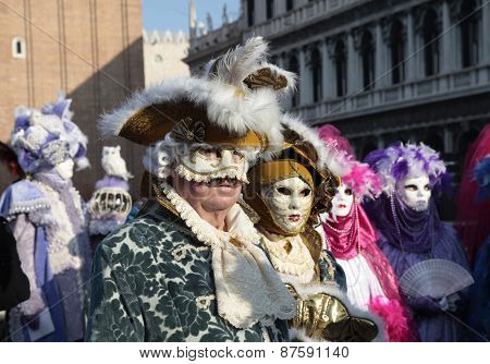 Masked Persons In Beautiful Medieval Costume On San Marco Square, Venice, Italy.