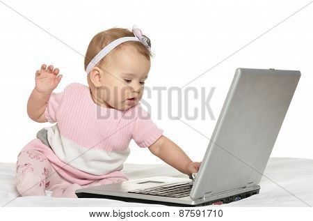 baby playing with laptop