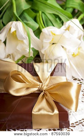 gift and white tulips