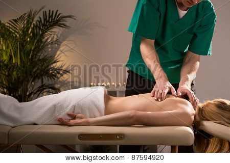 Chiropractor Treating Young Woman