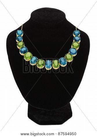 Pendant With Green And Blue Gem Stones On Black Mannequin Isolated On White