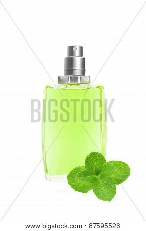 Perfume In Beautiful Blue Bottle And Mint Herb Isolated On White