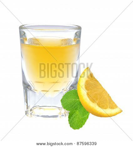 Glass Of Vodka With Pepper, Lemon Slice And Mint Leaf Isolated On White