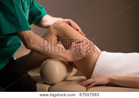 Masseur Doing Leg Massage