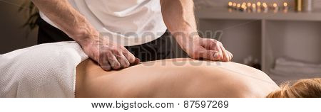 Masseur Doing Therapeutic Massage