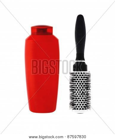 Red Shampoo Bottle And Hairbrush Isolated On White