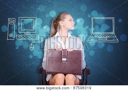 Businesswoman Deciding Between Desktop and Laptop
