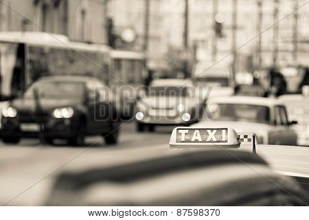 Taxi On City Streets Of Beige Color