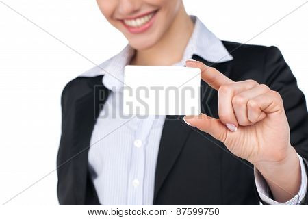 Businesswoman In Suit Holding Empty Business Card