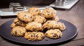 picture of baked raisin cookies  - Cookies with raisins on wooden table - JPG
