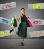 stock photo of going out business sale  - Cheerful girl go to shopping with sale - JPG