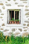 stock photo of farmhouse  - Detail of a window of a typical farmhouse in muehlviertel - JPG