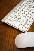 picture of field mouse  - A keyboard, mouse, and drawing pad set against an oak wood background ** Note: Shallow depth of field - JPG