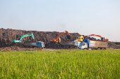 pic of landfills  - Garbage Trucks work on the landfill environmental - JPG