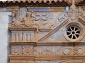 picture of panther  - The church of Nuestra Senora de Regla in Pajara in Spain has interesting sculptures of sun pattern snakes panther and birds above the main entrance - JPG