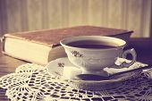 picture of poetry  - Cup of tea with poetry book on napkin in vintage effect - JPG