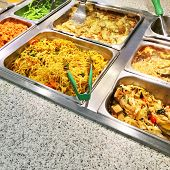 stock photo of buffet catering  - Variety of vegetarian food in metal containers in a catering buffet - JPG