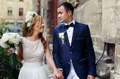 picture of married  - happy just married young couple celebrating and have fun at beautiful cathedral - JPG