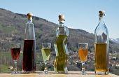 picture of liquor bottle  - photo of three bottles of liquor and glasses full - JPG