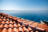 picture of roof tile  - Red tile roof on the sea background - JPG