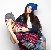stock photo of swag  - Fashion portrait of two stylish sexy hipster girls best friends - JPG