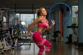 pic of hula hoop  - Middle Age Womane Playing Around With Hula Hoop Rings - JPG