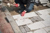 foto of pavestone  - Construction worker installing the pavestone on the road - JPG