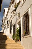 stock photo of costa blanca  - Charming narrow old town street in Altea Costa Blanca Spain - JPG