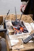 stock photo of blacksmith shop  - old village blacksmith forge with hot coals