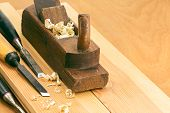 pic of chisel  - Old joiner plane and chisel on wooden background - JPG