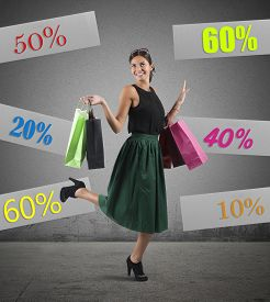 foto of going out business sale  - Cheerful girl go to shopping with sale - JPG